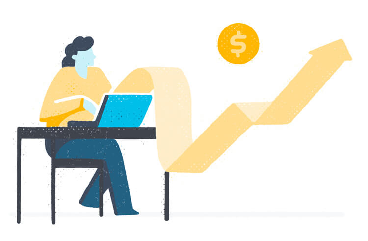 Woman on a computer with a money graph.